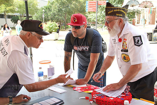 Service officer Paul Rodriguez and Post Quartermaster Robert Garza explain the benifits of joining the Veterans of Foreign Wars to nursing freshman Richard Cote. File