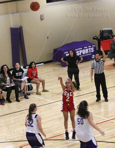 Kinesiology freshman Destiny Solis shoots an open 3-pointer as coach Haley Capestany observes in the background. The Rangers fell short to the Wildcats after overcoming an 18-point deficit in the third quarter.