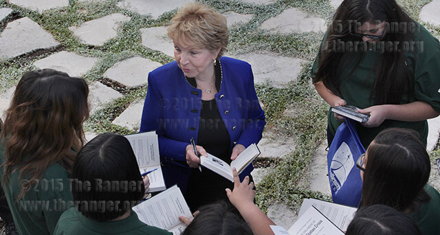 "Dr. June Scobee Rodgers, widow of Challenger commander Francis R. Scobee, signs copies of ""Star Challengers: Space Station Crisis"" for students from McAuliffe, McNair and Scobee middle schools after the VIP grand opening of Scobee Education Center Oct. 31, 2014. File"