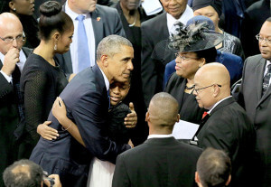 President Barack Obama hugged members of the Pinckney family June 26, in Charleston. Obama delivered the eulogy for Sen. Clementa Pinckney, at his funeral.  Paul Zoeller