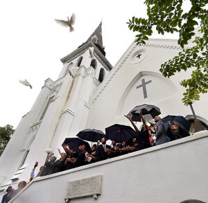 The Rev. DePayne Middleton Doctor's family members released doves from Emanuel AME Church after her funeral. She was one of nine people fatally shot during a Bible study at the church on June 17.  Wade Spees