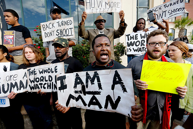People protest the shooting of Walter Scott by a North Charleston police officer during a demonstration against police violence April 8 in front of North Charleston City Hall. Photographer and former student Paul Zoeller of the Post and Courier in Charleston, S.C., will speak at the opening ceremony of Black History Month at 10:50 a.m. today in the auditorium of McAllister Fine Arts Center.  Paul Zoeller