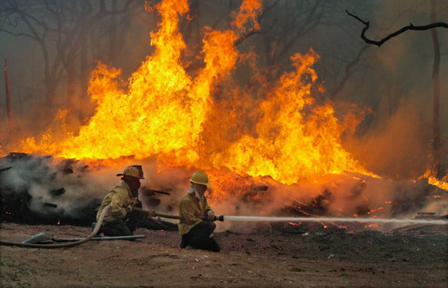 On Sept. 5, 2011, firefighters battled a wildfire on Highway 71 near Smithville. The wildfire destroyed more than 1,000 homes, and nearly two years later, recovery continues.  AccuNet/AP