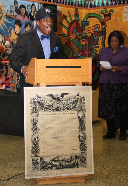 """Music business sophomore Darryl D. Dawson Sr. sings the African-American national anthem, """"Lift Every Voice and Sing"""" by James Weldon Johnson with the help of Counselor Carolyn Foster playing the piano Tuesday during the Black History Month opening ceremony in the Fiesta Room of Loftin.  Monica Correa"""