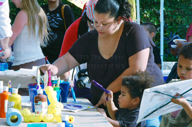 Math sophomore Susan Orozco helps her daughter Janessa paint a kite April 29, 2011, at the block party.  File