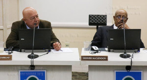 District 4 trustee Marcelo Cassillas and District 1 trustee Denver McClendon listen to the 2015 hotline summary report at Tuesday's board meeting in Kileen. The two are up for election in May. McClendon left the board meeting before executive session.  Photo by Kyle R. Cotton