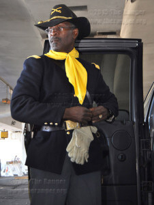 Turner McGarity adjusts his U.S. Army calvary uniform worn by Buffalo soldiers after the Civil War. McGarity said the Buffalo Soldiers were given that name by Native Americans due to their fighting strength.  Ingrid Wilgen