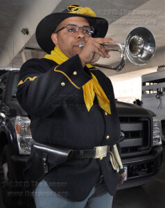 9th Cavalry Buffalo Soldier Dustin Mitchell practices a bugle call in the staging area.  Ingrid Wilgen