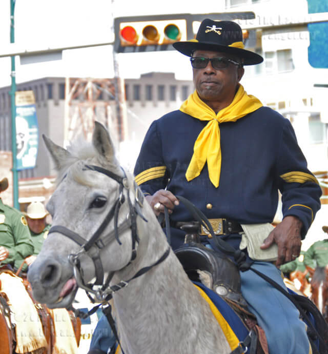 "Carl ""JJ"" Johnson and Shelly, his 18-year old Arabian mare, participate in the U.S. 9th Calvary Buffalo Soldier Saturday in the Western Heritage Parade.  Ingrid Wilgen"