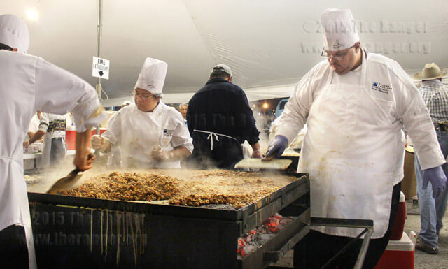 St. Philip's student Paul Menefee helps prepare chorizo for 6,000 tacos during the Cowboy breakfast Jan. 25.  Carlos Ferrand