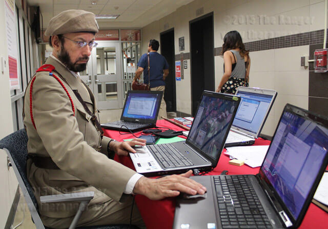 PC LAN technician Nestor Rivera installs and scans anti-virus software Wednesday in Moody.  Daniel Arguelles