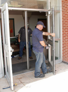 Installation manager Randy Tereau of Fairway Supply Inc. changes the locks on an exterior door Tuesday on the second floor east entrance to Gonzales.  Michael Peters