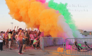 Cannons shoot colored cornstarch at the crowd during a Night-Time Graffiti Party.  Monica Lamadrid