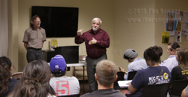 """Dr. Paul Wilson, right, director of the Murguía Learning Institute, and physics Professor Jerry O'Connor speak Oct. 1 at the Methodist Student Center on """"Fired Up for Gun Control.""""  Casey Alcala"""