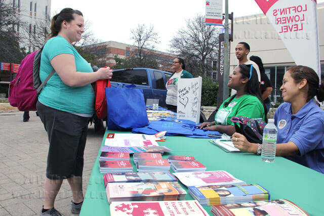Nursing sophomore Jana Holguin receives a free shirt and fliers about HIV and STD's from Jennifer Nobbie, community health coordinator with San Antonio Housing Authority, Feb. 7 during a free HIV testing event in the mall.  Monica Correa