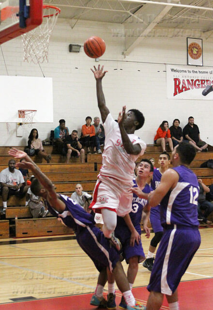 Art sophomore Devon Dickens soars above business sophomore Turundus Luckett as he attempts to score.  Daniel Arguelles