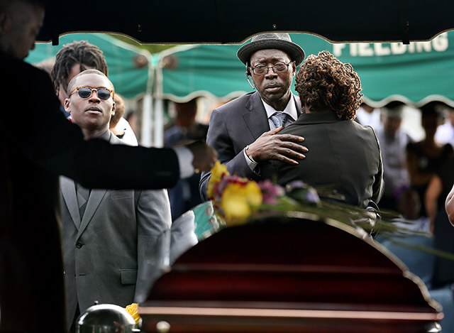 Parents of Tywanza Sanders, Tyrone Sanders and Felicia Sanders comfort each other at the graveside of their son Tywanza Sanders June 27, at Emanuel AME Cemetery in Charleston,S.C.  Grace Beahm