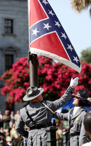 An honor guard from the South Carolina highway patrol removes the Confederate battle flag from the Statehouse grounds July 10 in Columbia, S.C.  Grace Beahm