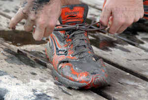 Students had to secure their shoes to prevent losing them in deep mud.  Monica Lamadrid