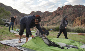 Sonography freshman Bianca Garza helps make camp by setting up a tent before sunset at Chisos Basin campground.  Monica Lamadrid