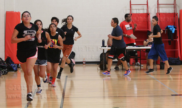 Kinesiology sophomore Priscilla Menchaca leads a cardio drill focusing on physical conditioning during women's basketball tryouts Sept. 6 in Gym 2 of Candler.  Daniel Arguelles