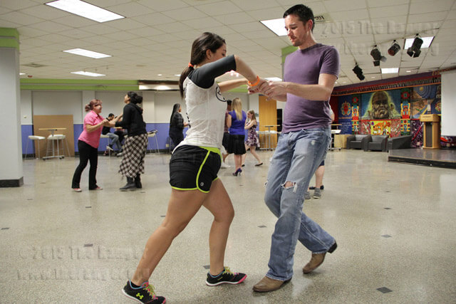 Psychology sophomore Jacob Wong teaches merengue dancing Sept. 18 in Loftin.  Monica Lamadrid