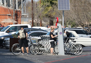 Whitt and Jamie Jones rent bicycles from the Big Tex B-Cycle Station Feb. 15 in the parking lot of Blue Star Art Complex. This B-Station is powered by solar energy just like the station outside Sinkin EcoCentro.  Photo by Hillary E. Ratcliff