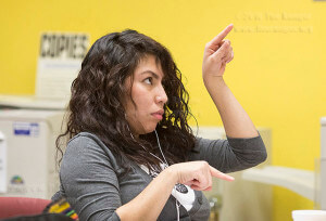 Nursing sophomore Areli Altamirano practices sign language at the BioSpot Wednesday in Room 350 of Chance. Altamirano reviewed the different signs for greetings, shapes, colors, ABCs and commands.  Photo by Vincent Reyna