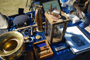 Buffalo soldiers set up a table of artifacts from the Civil War Feb. 10 in the mall in celebration of Black History Month. The table includes a spitoon, what soldiers used to spit tobacco in; a telescope; a lantern and a harmonica. In the back, artifacts include a lock, handcuffs, a flute, a compass and a reveille. Photo by Aly Miranda