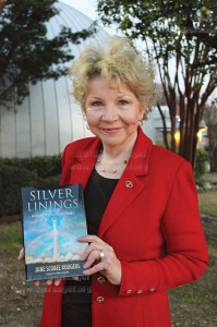 "Dr. June Scobee Rodger holds her book ""Silver Linings"" after a book-signing ceremony in February 2011 in front of Scobee Planetarium. Her late husband, Dick Scobee, was the commander for the 1986 Challenger mission.  File"