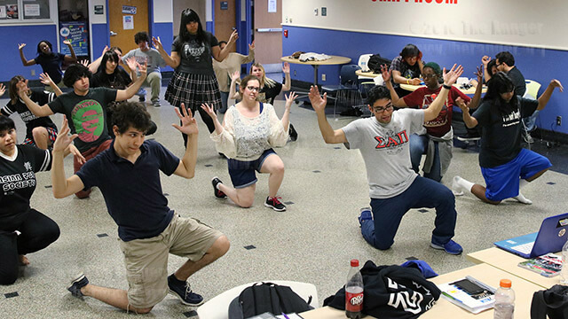 "The Asian Pop Society practices dancing to Korean pop singer Psy's ""Napal Baji,"" led by Federico Gonzalez-Vidal, art sophomore and president of the Asian Pop Society, in the craft room of Loftin Feb. 19. The dance club dances to Asian pop culture music with performances at this campus and local anime conventions. No experience is required to join, and people of all skill levels are welcome. The club meets 2-5 p.m. every Friday in the craft room.  Photo by Alison Graef"