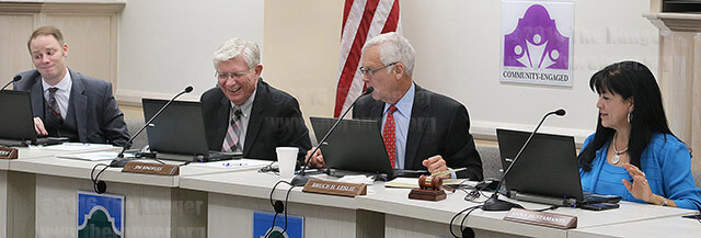 District 8 Trustee Clint Kingsbery, District 9 Trustee James Rindfuss and District 3 Trustee Anna Bustamante react to a joke told by Chancellor Bruce Leslie at the board meeting Feb. 16. Leslie joked transportation will no longer be an issue when we have vehicles that can fly.  Photo by Melissa Luna