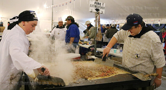 Criminology freshman Nikoli Berggren and volunteer Michael Peace prepare the filling for chorizo and egg tacos at the 38th annual Cowboy Breakfast. Student volunteers began working at 2 a.m. to prepare food. The breakfast is the unofficial kickoff to the San Antonio Stock Show and Rodeo. Proceeds benefit St. Philip's College's culinary arts program. Go online for more photos. Photo by Kyle R. Cotton