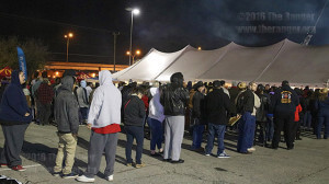 Crowds lined up as early as 2:30 a.m. for free breakfast tacos during the 38th annual Cowboy Breakfast. The Cowboy Breakfast is expected to set the record for most tacos served.  Photo by Kyle R. Cotton
