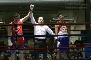 Nicolas Ramirez from Ramos Boxing Team is declared the winner over nursing sophomore Alfred Serna after an unanimous decision. The judges scored the fight 3-0 in favor of Ramirez. Photo by Alejandro Diaz