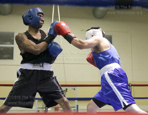 Michael Shields, from team Alcoser, blocks a punch from Antonio Chavez, unattached, during their fight in the 152 pounds Welterweight class Tuesday in the Golden Gloves Regional Tournament at Woodlawn Gym. Photo by Alejandro Diaz