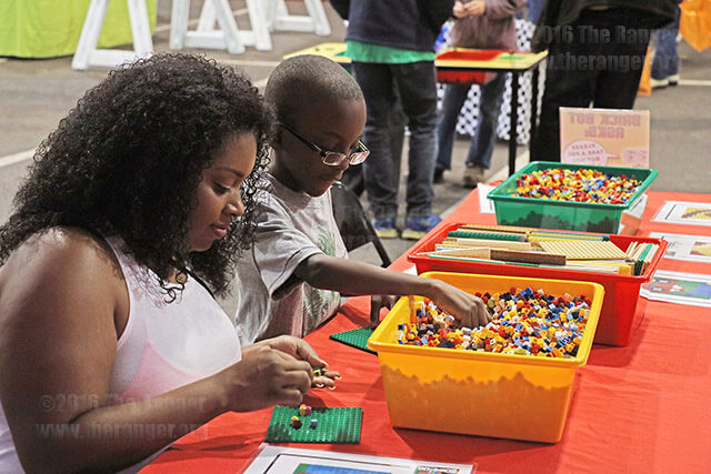 Education sophomore Amber Renney and son Aiden, 8, construct their own Lego designs at the Brick Fest Live tent Feb. 13.  Photo by Wally Perez