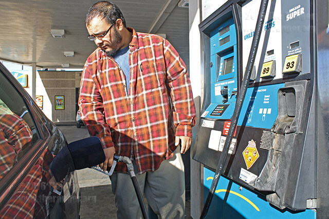 "Damon Ornelas, radio-television-broadcasting sophomore, fuels his vehicle before class Tuesday at the Valero on San Pedro across from campus. ""I'm glad the prices are down because it is less of an impact on my wallet,"" Ornelas said. ""But I'm also curious how they are able to be low. What are we sacrificing?""  Photo by Ryann Palacios"