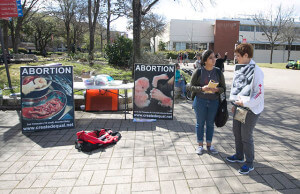 Liberal arts sophomore Alyssa Trujillo converses with computer science graduate Rosemary Glass about their views on abortion during a rally Tuesday in the mall. Glass said she used to be pro-abortion rights, but changed her views to show support for the unborn babies and the women that had to endure pregnancy. Photo by Vincent Reyna