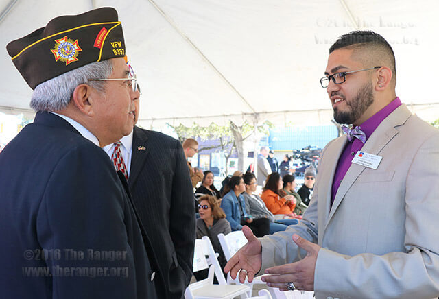 Business administration sophomore Victor Hernandez, Student Veterans Association president, talks with Cris Vieyra Jr., Commander of VFW Post 8397, before the Victory Center groundbreaking ceremony at this college Wednesday. Photo by Melissa Luna