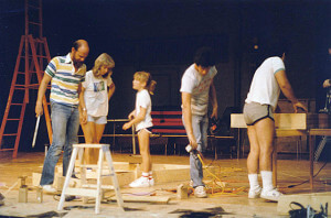 "David Mrizek, his wife Ann and his daughter Emily help put together the set for ""Hold on,"" in the 1980s. File"
