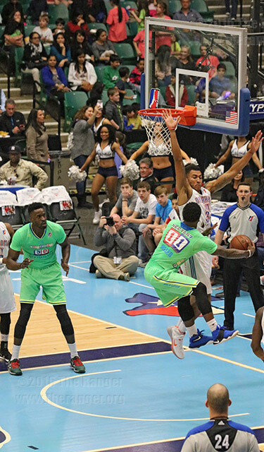 Legends Patrick Miller swings a pass around Blue defender Josh Huestis to set up Micheal Eric for an easy lay-up April 1 at Dr. Pepper Arena in Dallas. The  Legends combined for 30 total assists as they cruised past the Blue 139-109.  Brandon A. Edwards