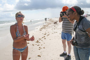 Florida Beach enthusiast explains the oil clumps she is finding on her walk with Ranger editors 2010.  File