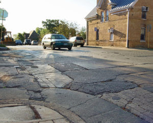 Multiple cars pass through the intersection of West Ashby Place and Belknap Place at 7:45 a.m. Wednesday. Belknap Place is the oldest concrete street in Texas. Most streets or roads usually have a physical life cycle of fewer than 50 years. The Cement Council of Texas and the Monte Vista Historical Association will erect historical marker May 21. Photo by Raffy Gubser