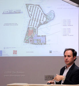 Adam Reed, principal architect at Ford, Powell and Carsons Architects and Planners Inc., presents four concept designs for the new district support operations building during the Building, Grounds and Sites Selection Committee meeting July 19 in Killen. The southern design showcased two four-story buildings with the acequia running through the Playland site. Photo by Wally Perez