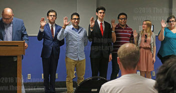 President Robert Vela cites the oath for the officers to say in the Fiesta Room for the Student Government inauguration Thursday. The officers were banking sophomore Christopher Scoggins as treasurer, art sophomore Federico Gonzalez-Vidal as secretary, pre-pharmacy sophomore Quintin Longoria as vice president, psychology sophomore Brett Douglas as historian, psychology sophomore Harley Williams as president and accounting sophomore Jenna keeton as comissioner of public relations. All officers have their position for the whole school year. After spring break, Mark Bigelow, interim director of student life puts information out for students to apply for SGA positions on orgsync.  Photo by Aly Miranda