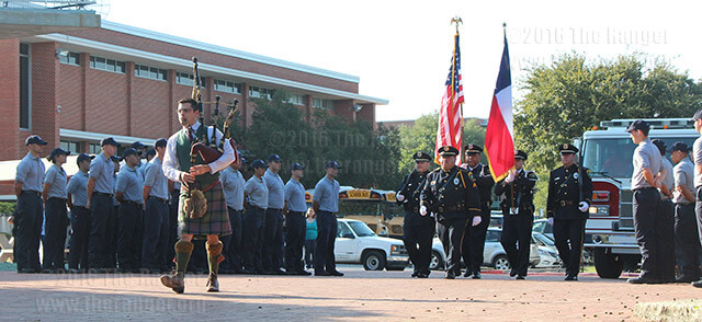 Robert Chalk, Alamo City Pipes and Drums' pipemage leads a procession during this college's 9/11 remembrance ceremony as fire academy students stand in formation and wait to join the procession. Chalk was followed by the Alamo Colleges honor guard holding the colors, a fire engine, fire academy students, police vehicles and a hearse. The procession went from Candler to the 9/11 memorial marker in northwest of Chance. Photo by Kyle R. Cotton