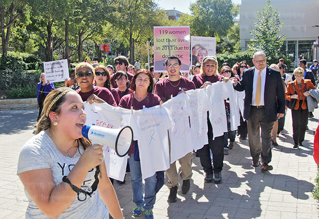 "Dental hygiene sophomore Stephanie Contreras leads a chant of ""speak up!"" with students, staff and faculty from this college in a march against domestic abuse Oct. 15, 2014. File"