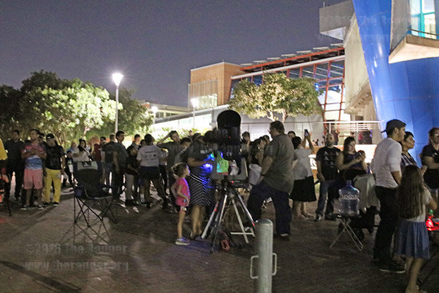 People gather between Scobee and Candler in hopes of getting a quick look at Saturn's rings through multiple telescopes at the harvest moon party Sept. 16 at Scobee. photo by M.J. Martinez