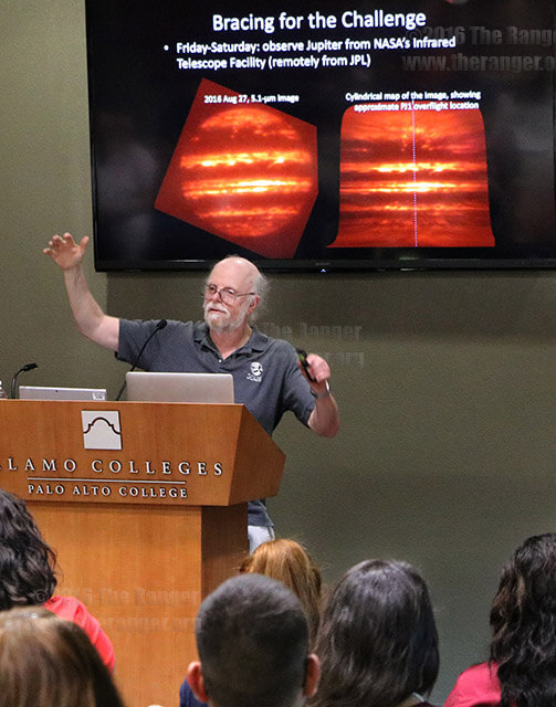 Dr. Glenn Orton, senior research scientist at the Jet Propulsion Laboratory in Pasadena, California, shows images of Jupiter captured from NASA's Infrared Telescope Facility Aug. 29 in the Legacy Room of Ozuna at PAC. Dr. Orton discussed future travels around Jupiter, showed diagrams of Juno's orbit and answered questions from faculty and staff. Photo by Brandon A. Edwards